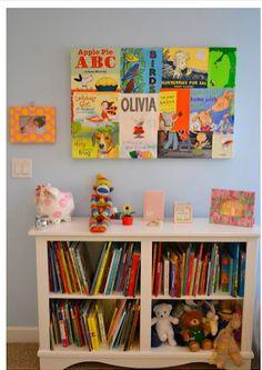 Book covers into wall art.  Great idea for kids favorite books!!