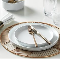 graphic design. Industrial powder-coated iron sets your place in a herringbone pattern and a copper. Handcrafted in an intricate process, pieces of wire are individually cut then welded to an outer ring. Sets a modern tone at the table as a placemat, charger or trivet for hot dishes.