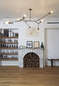 Shelving Next to Fireplace and Chandelier Inspiration
