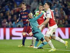 Barcelona's Argentinian forward Lionel Messi (L) looks on after shooting to score a goal next to Arsenal's Brazilian defender Gabriel (2nd R) and Arsenal's Colombian goalkeeper David Ospina (2nd L) during the UEFA Champions League Round of 16 second leg football match FC Barcelona vs Arsenal FC at the Camp Nou stadium in Barcelona on March 16, 2016.