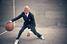 an Old man play to basket .. this picture is funny !