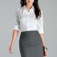 White work wear office button up blouse Basic white 3/4 sleeve button up blouse. Perfect for the office or work that requires a nice white shirt. Waitress uniform shirt. Flattering and form fitting. Office staple. ( Cover image is for styling purposes, not exact piece) Merona Tops Button Down Shirts