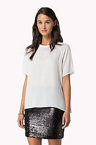 As selected by our guest editor, Alexa Chung.<br/><br/>Let the party season begin! Chiffon top in an elegant, minimalist styling. Crew neck, slight A-frame styling in a regular fit. Wider raglan sleeves for easy movement. Tommy Hilfiger logo above the hemline.<br/><br/>Our model is 1.76m and is wearing a size S Tommy Hilfiger top.