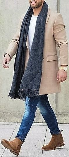 Beige / Tan / Camel Overcoat . Charcoal Scarf . White T-Shirt . Mid Blue Jeans . Tan Chelsea Boots