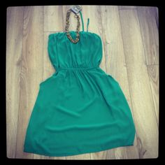 Green strapless dress. Looks great on!