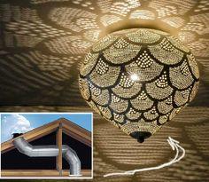 Solatube vanaf dak komt uit op Oosterse lamp op de begane grond (of slaapkamer eerste verdieping)