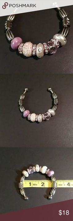 SILVERTONE BRACELET Cute bracelet with removable rhinestone and glass beads. Just unscrew the round end cap at the end of the bracelet and remove or add beads to your liking.  You can arrange them in any order that you choose.  Preowned and looks like new. Jewelry Bracelets