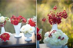 do smaller but more vases with other red flowers than roses. the shower should be less formal than the wedding and big bouquets of red roses are tacky. use poseys, white roses, babys breath, etc