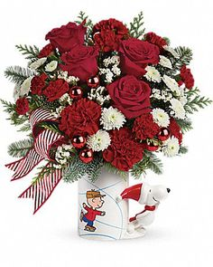 """This holiday season Teleflora has joined up with the Peanuts gang to celebrate the 50th Anniversary of """"A Charlie Brown Christmas"""".  They have two exclusive floral bouquets and a festive lineup for decorating your home or gift giving."""