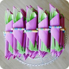 Candy bracelets used as napkin rings. An easy way to add some fun to a little girls birthday party. I bet teenage girls would love this too.