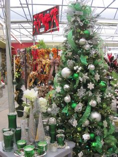 green white and silver christmas tree with ornaments ribbon snowflakes from - Green And Silver Christmas Decorations