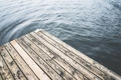 Minimalistic Shot of a Wooden Pier on a Lake Free Image Download