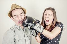 Angry woman boxing his boyfriend