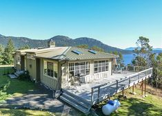 Orcas Island, #sanjuanislands vacation rental. This secluded home enjoys sweeping views looking south over East Sound. The home is found by driving down the beautiful wooded Lois Lane before it opens up to home site. A large wrap around deck is an ideal place to enjoy the warm summer sun. #travel