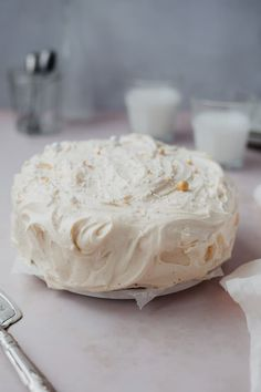 A cardamom cake frosted in cream cheese frosting with gold and white sprinkles on top. There are two small glasses of milk behind the cake Butter Cream Cheese Frosting, Make Cream Cheese, Cream Cheese Eggs, Apple Custard, Cardamom Cake, How To Make Frosting, Spice Cake, Rice Krispie Treats, Brown Butter