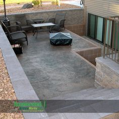 This is ingenious! Window wells are usually so dark and unfriendly...but this homeowner turned theirs into a secluded patio space that is out of the sun and wind! It lets in much more light to the basement and it easier to clean than a traditional deep egress one with a ladder access. The patio area is done in a stamped concrete inside a Versa-Lok retaining wall and step system.