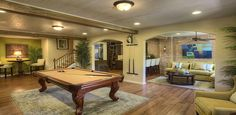 The basement of this Atlanta new home model includes a room to play pool. Luxury Swimming Pools, Luxury Pools, Basement Floor Plans, Basement Ideas, Basement Pool, Build My Own House, Play Pool, Wet Bars, Wood Bridge