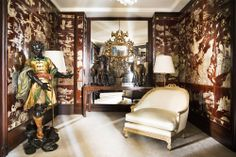 Coco Chanel's Paris Apartment - The designer was an avid collector of Coromandel screens, which she used to panel her walls and frame her doorways.