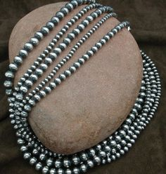 These beads are made of solid sterling silver and strung on a foxtail wire. The necklace is then finished off with a hook and eye. Necklace consists of 5 strands of different size seamless beads. The entire necklace is approximately 18 inches in length. The beads can be worn layered or twisted for the look you desire. A matching bracelet is available on our bracelet page as well as the matching earrings on the earring page. These beads are casual enough to wear shopping yet formal enough for…