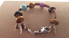 Red Bali Frog bracelet, lock and beads. Beads are gemstones, and natural materials such as bamboo, coconut, lava rock.