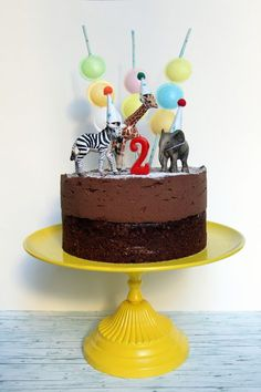 Easy animal party hat parade and candy skewer birthday cake decor | via www.thebearandthefox.com