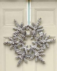 Painted pine cone snowflake wreath for winter door decor