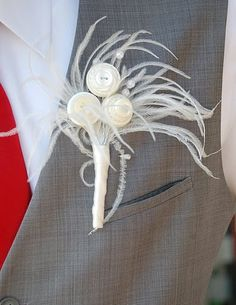 feather and button boutonniere matched my bouquet and hairpiece