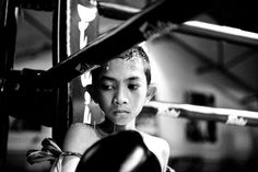 The Child Fighters of Thailand: A Muay Thai fighter in the boxing ring during the break. Photo by Sandra Hoyn