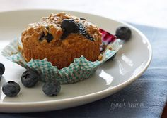 Whole Wheat Blueberry Muffins - Moist and delicious low fat whole wheat muffins loaded with blueberries in every bite!