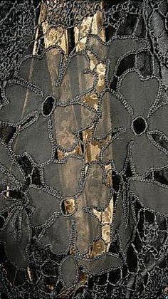 1926 Poiret dress of black silk tulle & crepe, gold lamé, chainstitch embroidery in metallic thread, bugle beads, & faux pearls. Detail view, image 2 of 2. Musée Galliera, Musée de la Mode de la Ville de Paris.