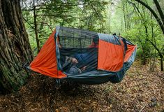 "Touted as ""the only camping hammock that sleeps two occupants comfortably,"" the Vertex Double Hammock Tent lets you share the rest nest with that special Camping Hacks, Camping Bedarf, Camping World, Camping Essentials, Camping Survival, Family Camping, Outdoor Camping, Outdoor Gear, Camping Ideas"