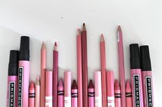 Pink pencils, crayons and markers.