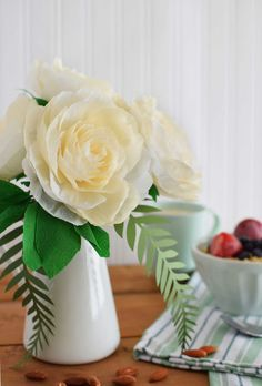 DIY Crepe Paper Garden Rose in white with fern and eucalyptus leaves from…