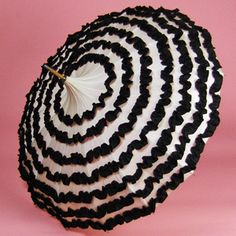 Pagoda Parasol: first half of 20th century, seven layers of ruffles, black post with ivory knob.