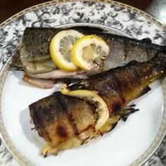 Whole trout stuffed with herbs and flavorings, then grilled directly on grates, produces flavorful, flaky, tender fish with tasty crispy skin.