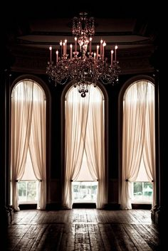 chandelier, sheer curtains, arched windows