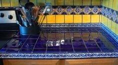 tiles Countertops blue yellow mexican tiles kitchen countertop and backsplash design ideas Kitchen Counter Tile, Mexican Tile Kitchen, Mexican Kitchens, Kitchen Countertops, Mexican Tiles, Blue Countertops, Tile Counters, Yellow Tile, Blue Yellow