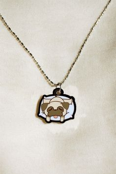 "Pudge the Pug charm necklace. charm is made of laser-cut acrylic and is approximately 1"" tall and is about 1/16"" thick. comes complete with a silver chain (around 18"" long). $12.00 #jewelry #dog"