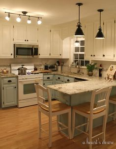 White uppers and blue lowers... I like the counter with a space to eat, too.