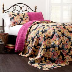 Dress your bed in bohemian-chic style with this eye-catching cotton quilt set, showcasing a paisley motif that reverses to a geometric print.  ...