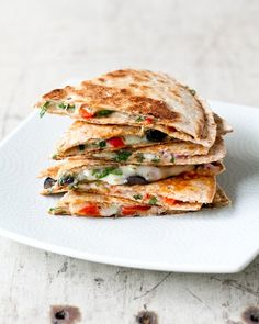 Discover how to take your quesadilla to the next level. These recipes are the best ways to upgrade a simple meal. From sprouts to kale, these simple ingredient additions will up your quesadilla game. For more, head to Domino. Greek Recipes, Mexican Food Recipes, Vegetarian Recipes, Cooking Recipes, Healthy Recipes, Spinach Recipes, Yummy Recipes, Healthy Weeknight Meals, Vegetarian Lunch