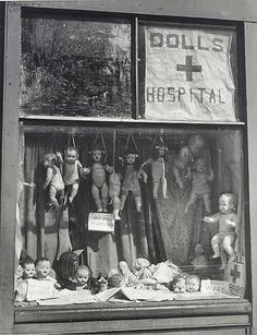 The Dolls Hospital. Looks macabre with the dolls hanging by strings in the window. Antique Photos, Vintage Pictures, Vintage Photographs, Old Pictures, Old Photos, Old Dolls, Antique Dolls, Creepy Dolls, Weird And Wonderful