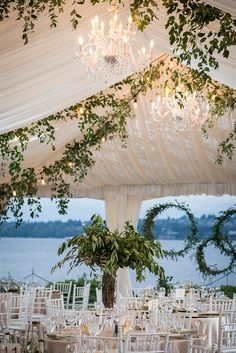 Bringing nature into the tent brings about an airy feeling to your reception.