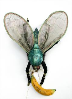 "ANDREA URAVITCH FRUIT FLY WITH BANANA  Clay, steel, fabric, fiber, crochet fiber  20"" x 18"" x 8""  Private Collection"