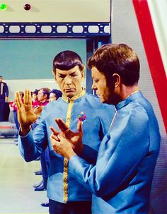 """McCoy: """"How does that Vulcan salute go?"""" Spock demonstrates. McCoy: """"That hurts worse than the uniform."""" From Journey to Babel (Star Trek)"""