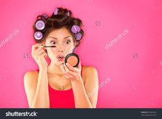 Makeup Mascara Woman With Hair Rollers Getting Ready Looking In Pocket Mirror. Funny Image Of Beautiful Trendy Young Mixed Race Asian Caucasian Female Fashion Model Putting Makeup On Pink Background. Стоковые фотографии 99647603 : Shutterstock