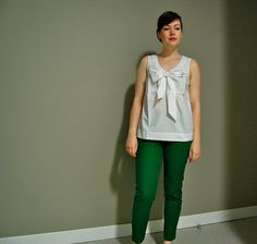 green pants with crisp white top