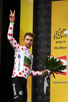 Taylor Phinney of the United States and Cannondale Drapac Professional Cycling Team celebrates on the podium in the King of the Mountins jersey...