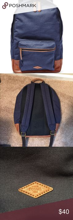 Navy Fossil Book bag Navy and tan leather. Used only a few times. Padded laptop sleeve. 3 inside pockets. One outside zipped pocket. Fossil Bags Backpacks