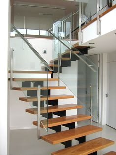 This staircase has an almost floating step effect with open rise steps and off-set stringer support. Pinterest Home Decor Ideas, Stair Handrail, Glass Balustrade, Painted Stairs, New Homes, Staircases, House, Stairs, Verandas